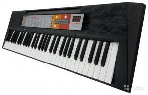 Фото Для дітей середнього та підліткового віку Гра на фортепіано (синтезатор)