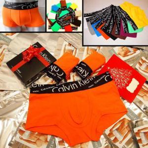 Фото Трусы Calvin Klein Italics Трусы Calvin Klein Italics black боксёры оранжевого цвета