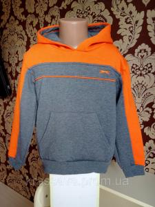 Фото Толстовки, худи, свитшоты для мальчиков Толстовка для мальчика на флисе Slazenger, оригинал, темно-серая с оранжевым, 5-6 лет/110-116 см/XXSB