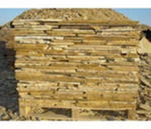 Фото  Камень песчаник желто коричневый на палетах