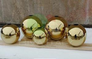 Фото  Нержавеющие пустотелые шары покрытые нитрид титаном
