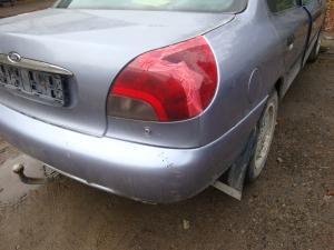 Фото Mazda, 323f, Кузовні деталі фаркоп