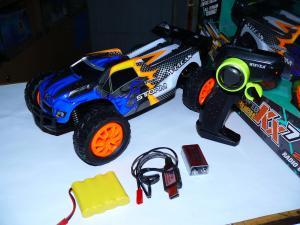 Фото Машины, багги, траги, монстры. Машинка трагги радиоуправляемая масштаб 1/14 , № W3676. Длина 31 см.