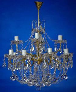 Фото Латунные люстры с хрустальными подвесками Двух-ярусная латунная люстра с хрустальными подвесками