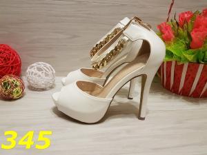 Фото Босоножки, шлёпки Босоножки белые на каблуке с цепочкой