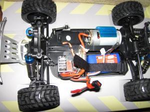 Фото Машины, багги, траги, монстры. Машинка шорт-корс WLtoys A969, полный привод 4X4, 29 см, 1:18 мсштаб.