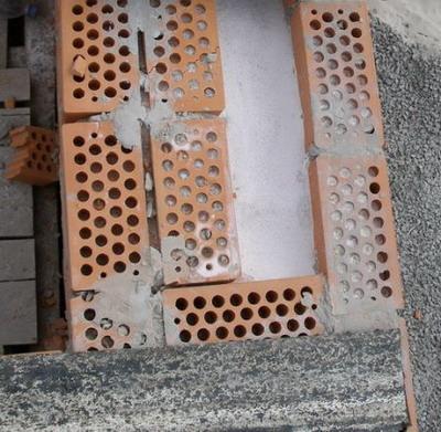 Утепление зданий методом задувки перлита в межстеновое пространство (работа + материал = 1300грн/м3)