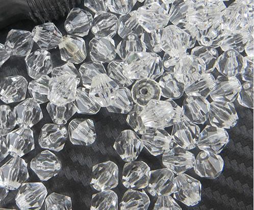 Фото  Бусина биконус 10х12 мм ,прозрачная акриловое стекло. Упаковка  30 штук