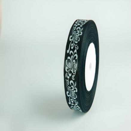 Фото Ленты, Лента атласная с узорами  и  надписями. Лента атласная  2,5 см.  черная с белым узором.