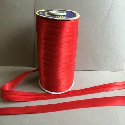 Фото Кружево ,тесьма ,сетка,резинка Косая  бейка  атласная.   Красного  цвета.    Ширина  15 мм.