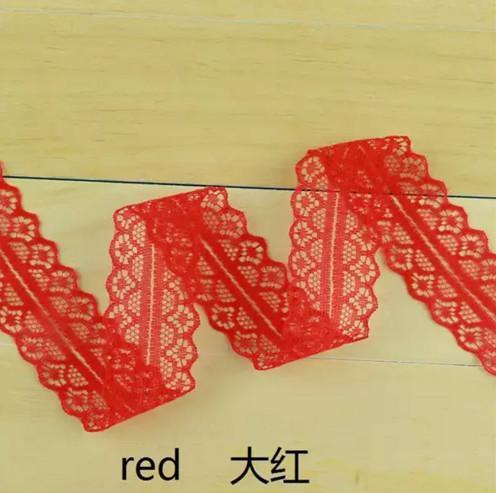 Кружево    капроновое.   Красного  цвета  ,  ширина -  27 мм.