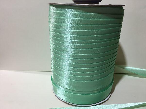 Фото Косая бейка атласная 1,5 см Косая  бейка  атласная.   Мятного  цвета.    Ширина  15 мм.