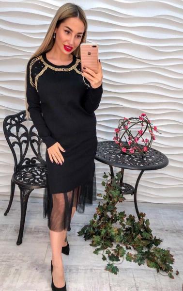 Стильный и нарядный черный женский костюм.