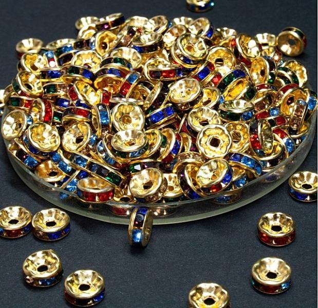 Фото Бусины ,полубусины ,стразы,.цветок, Бусины  разные Рондели  металические  8 мм.   Золотого   цвета  с  цветными  стразами .