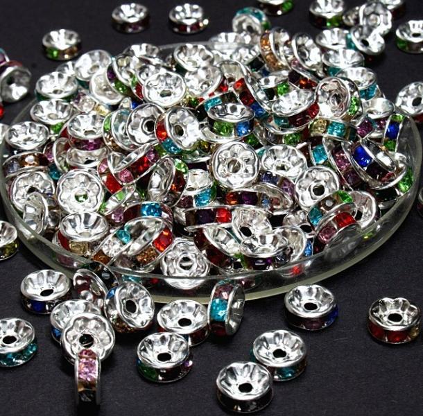 Фото Бусины ,полубусины ,стразы,.цветок.шина, тесьма пластик, Бусины  разные Рондели  металические  8 мм.  Серебряного  цвета  с  цветными  стразами .