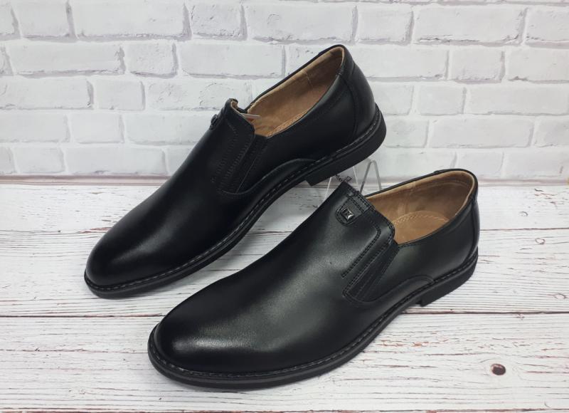 Мужские кожаные черные туфли.