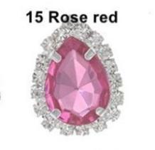 Металическая  основа  19 * 25 мм.  с  каплей      Розового  цвета  в  цапах   с  серебряной  цепочкой  и  белыми  стразами .