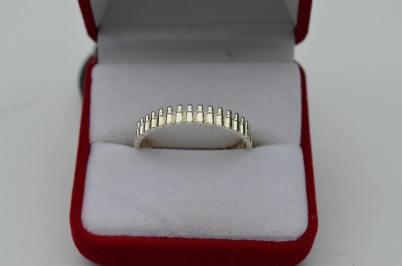 Серебряное кольцо пулемётная лента