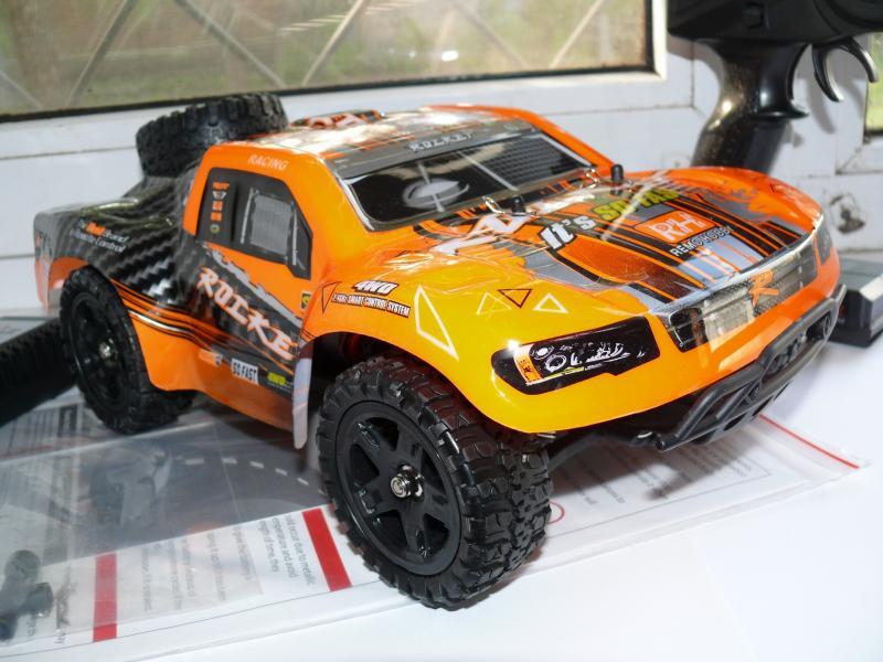 Машинка шорт-корс радиоуправляемая масштаб 1/16 , REMO HOBBY Rocket 1621 1:16 4WD. Длина 29 см, скорость 50 км/ч.