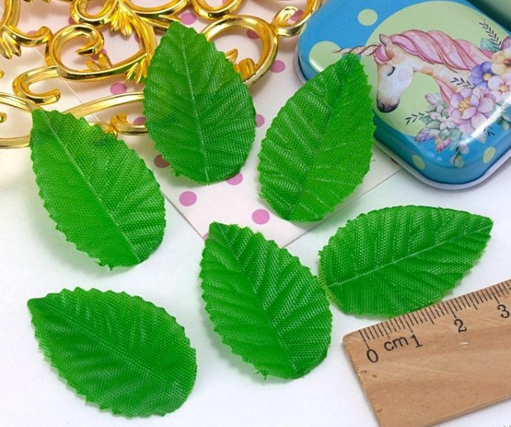 Фото Новинки Тканевые  светло - зелёные  листики.  40 * 25 мм.