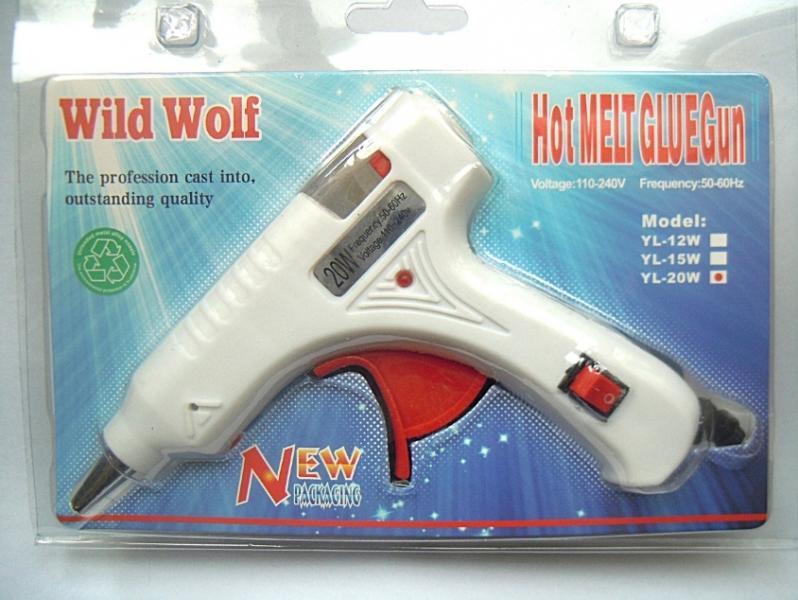 Фото Новинки Пистолет клеевой на 20 W , для клеевого стержня 7 мм. С кнопкой выключения и металической ножкой подставочкой .