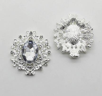 Фото Серединки ,кабашоны, Серединки с жемчугом и стразами Металическая серединка  25 * 27 мм . Серебряного цвета  с  Белой  серединкой .