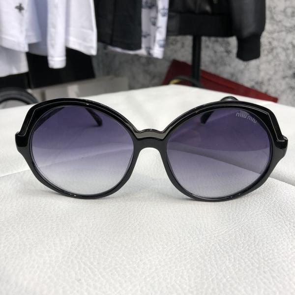 Miu Miu Sunglasses Round Reveal Black