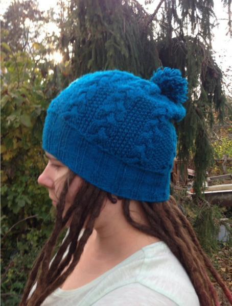 Синяя шапка с косами и помпоном