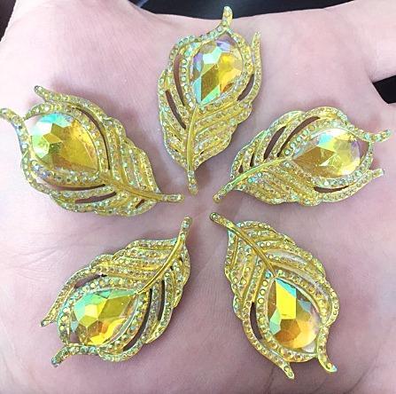 Фото Серединки ,кабашоны, Серединки с жемчугом и стразами Перо  павлина  20 * 38 мм.  Пластик - кристал.