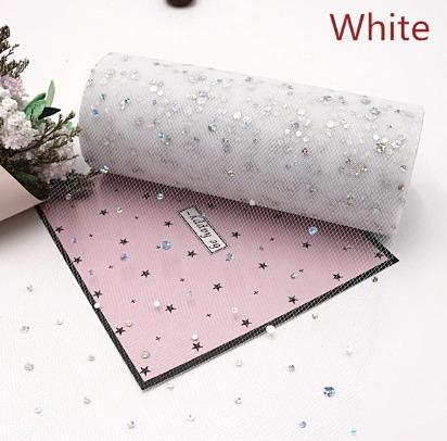 Фото Новинки Фатин  ширина  15 см.   Белого  цвета  с  круглыми   блёсточками .