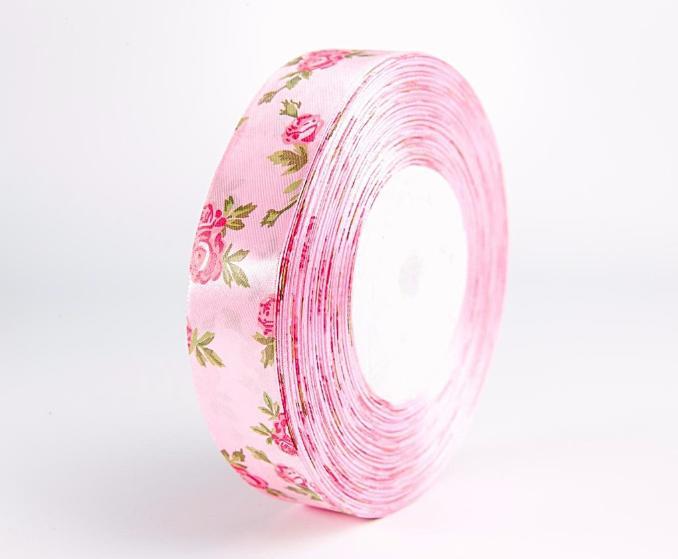 Фото Ленты, Лента атласная  с цветочками Лента  атласная  2,5 см.   Розового  цвета  в  малиновых  розочках .