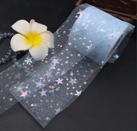 Фото Фатин ,регилин ,лазерная лента Фатин  тонкий , мягкий .  Голубого  цвета  , ширина  6 см. с  Радужными  блёсточками  и  Звёздами.
