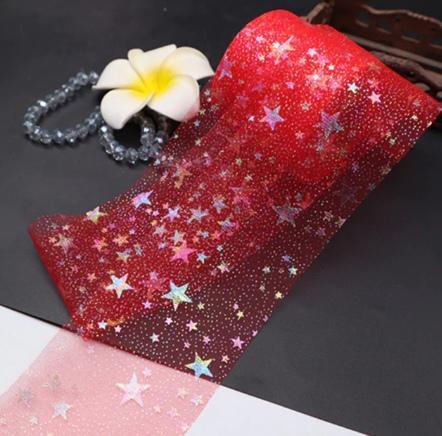 Фото Фатин и регилин Фатин  тонкий , мягкий .  Красного  цвета  , ширина  6 см. с  Радужными  блёсточками  и  Звёздами.