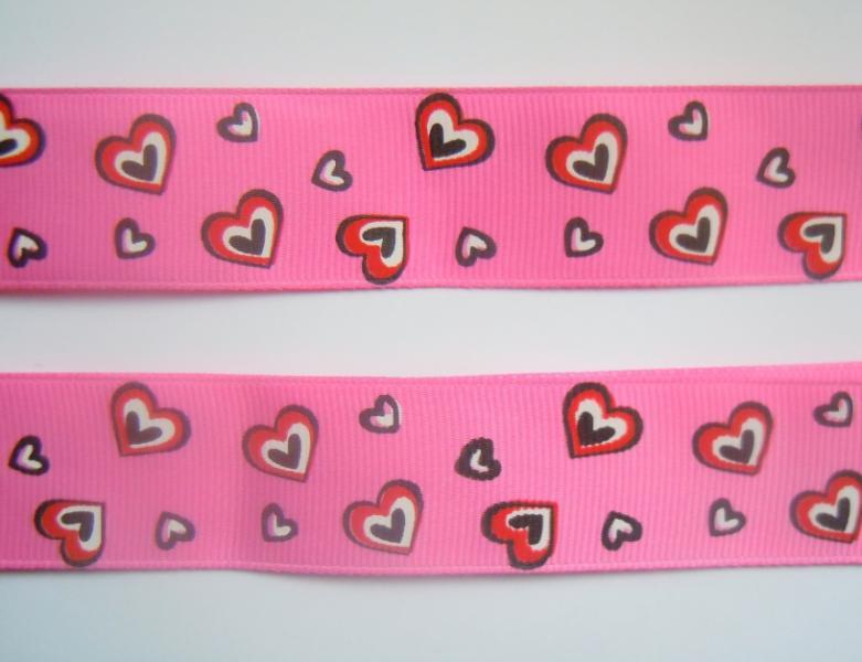 Фото Ленты, Лента репсовая с рисунком Репсовая  лента 2,5 см.   Ярко - Розовая  в  цветных сердечках .