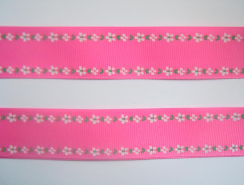 Фото Ленты, Лента репсовая с рисунком Лента репсовая  2,5 см.  Ярко - Розовая  с белыми цветочками  в  два  ряда.