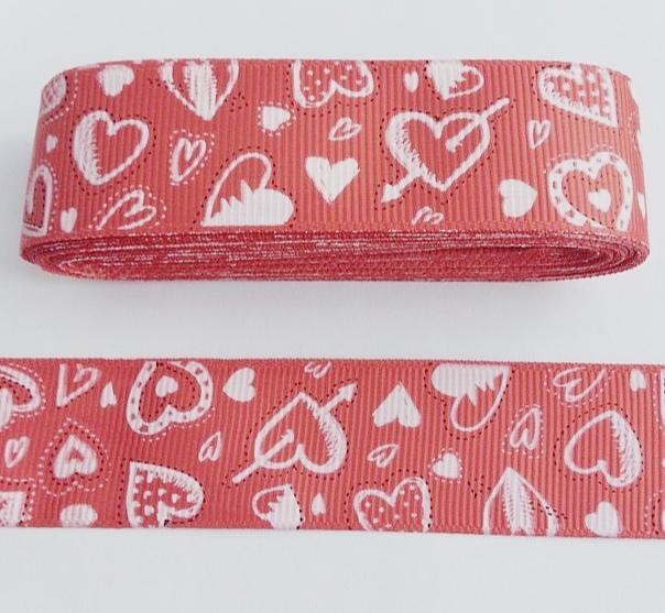 Фото Ленты, Лента репсовая с рисунком Репсовая лента 2,5 см.  Коралловая в разных сердечках . ( Упаковка остаток 1 м 24 см. )