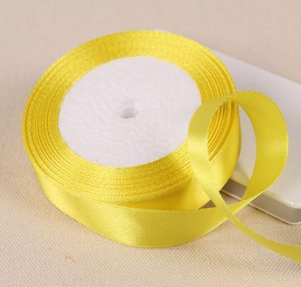 Фото Ленты, Лента атласная однотонная 2,5 см и с люрексом Лента атласная 2,5 см.  Жёлтого  цвета.