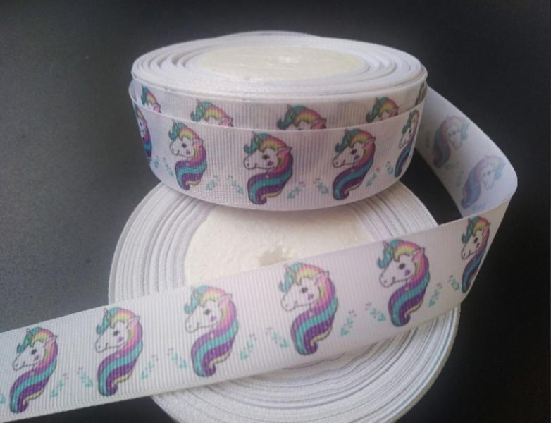 Фото Ленты, Лента репсовая с рисунком Репсовая лента 2,5 см. Белого цвета с Единорожком .