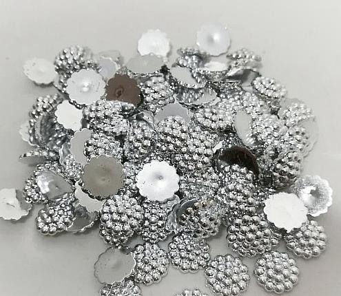 Фото Серединки ,кабашоны, Кабашоны, камеи Полубусина   пластиковая , акриловая . Серебряного  цвета  в  пупырышках   Размер   13,5 мм.
