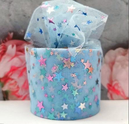 Фото Фатин ,регилин ,лазерная лента Фатин тонкий , мягкий . Голубого цвета , ширина 6 см. в цветных блестящих звёздочках .